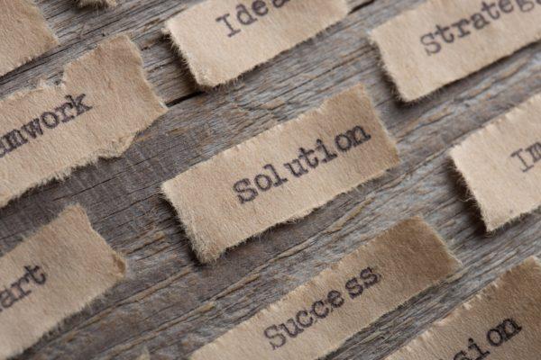 types words on paper scraps