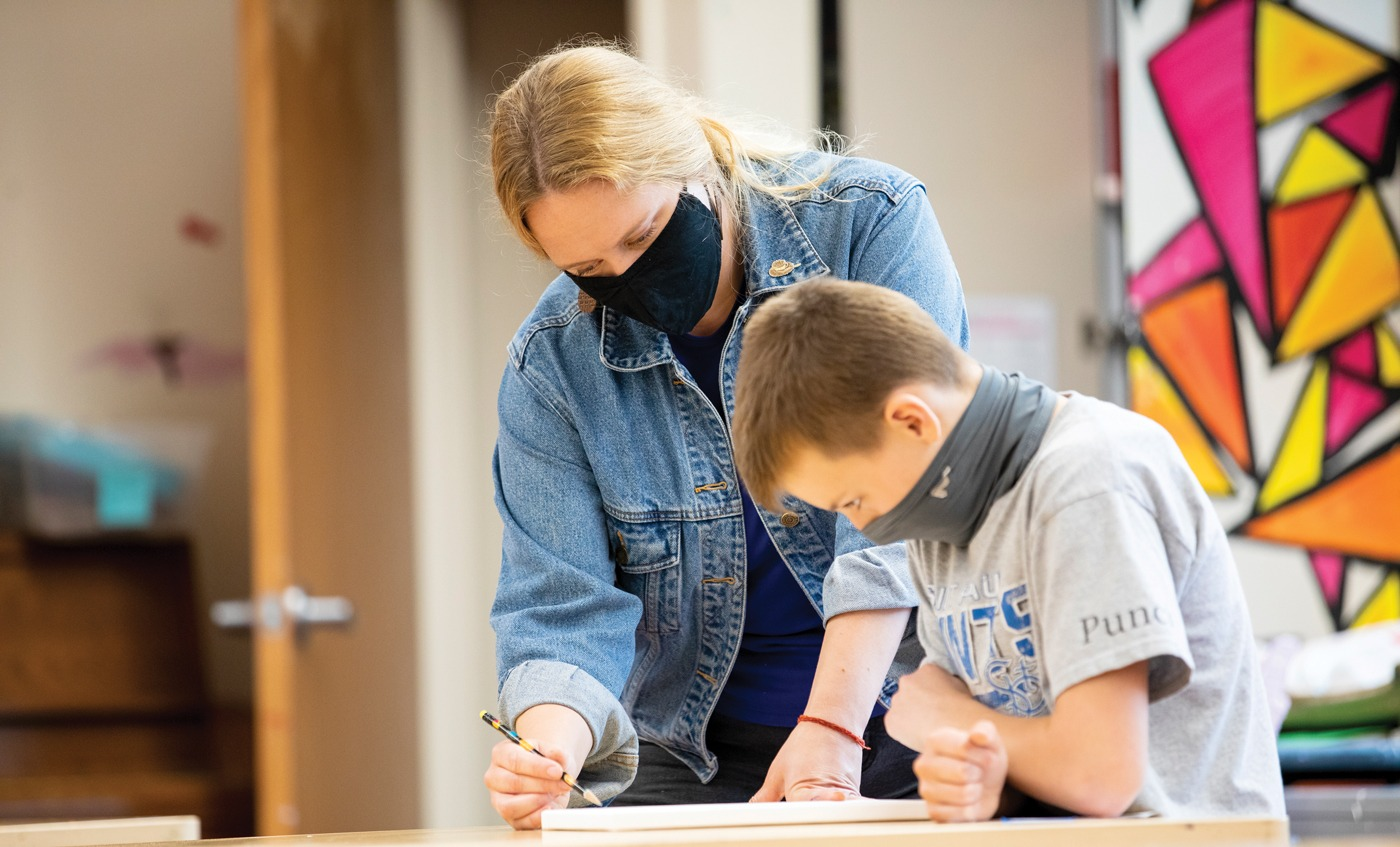 a Groves teacher works with a student during the 2020-2021 school year
