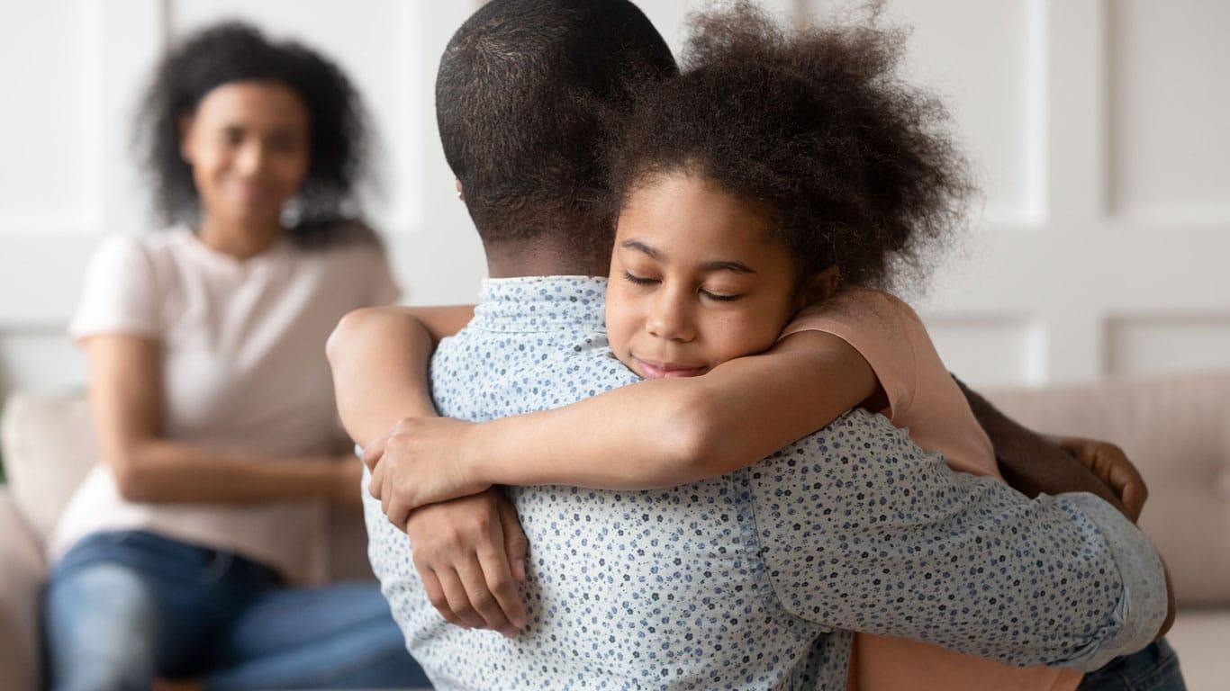 photo of parent hugging child