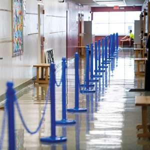 stanchions used to socially distance Groves students during COVID-19