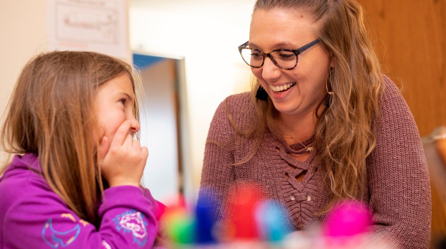 speech-language therapist talking to a student