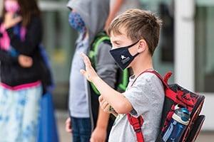 boy wearing mask