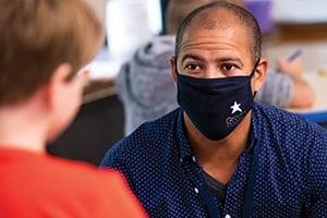 male teacher wearing mask